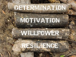 Inspirational and motivational words of determination motivation willpower resilience. Stock photo.