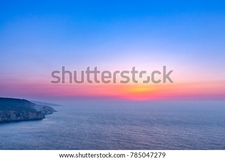 Inspirational and relaxing sunrise or sunset in the sea, beautiful sunrise or sunset above the sea landscape background. Twilight colors and natural sunlight inspirational beach nature