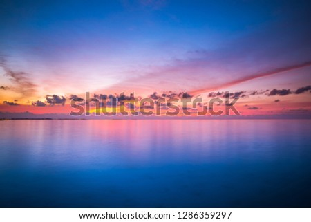 Inspirational calm sea with sunset sky. Meditation ocean and sky background. Colorful horizon over the water. Calmness, zen, tranquility concept, freedom and carefree design, nature scenery #1286359297