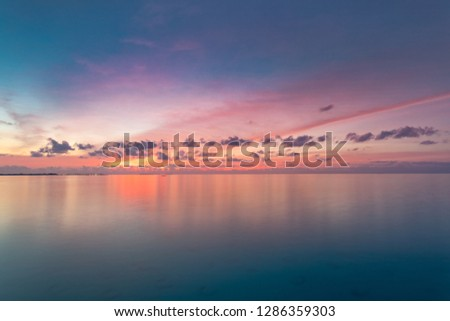 Inspirational calm sea with sunset sky. Meditation ocean and sky background. Colorful horizon over the water. Calmness, zen, tranquility concept, freedom and carefree design, nature scenery #1286359303