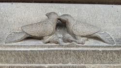 Inspirational historical architectural art handmade stone craft two bird kissing art for statue design, stone sculpturing, hindu culture.