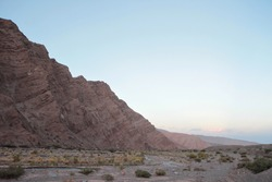 Inspirational landscape. Beautiful view of the desert and rocky mountain at sunset.