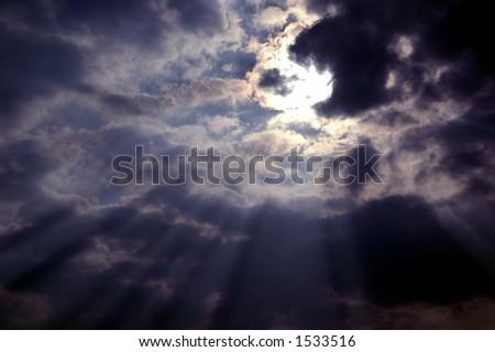 Inspirational light rays through dark clouds