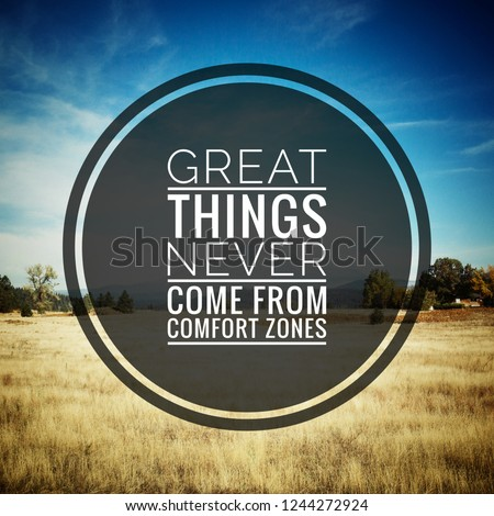 """Inspirational motivating quotes """"Great things never comes from comfort zone"""" on blurry motivational background."""