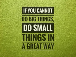 Inspirational motivation quote If You Cannot Do Big Things, Do Small Things In A Great Way on green concrete wall background.