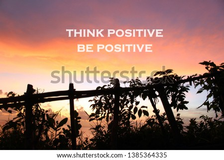 Inspirational motivational quote- think positive, be positive. With natural wooden fence and wild plants silhouette on the edge of the cliff, with beautiful sky colors background. Words of wisdom. #1385364335