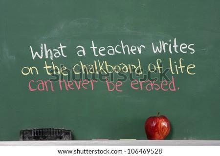 Inspirational phrase for teacher appreciation written on chalkboard of classroom.