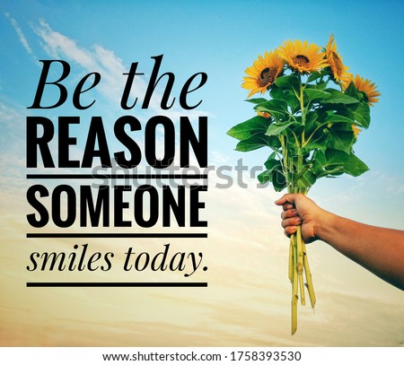 Inspirational quote - Be the reason someone smiles today. With a hand holding a bunch of sunflowers against bright blue sky background. Motivational text message with flowers and sky background. Photo stock ©
