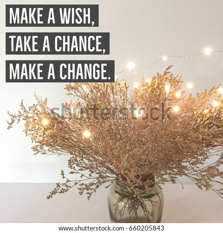 "Inspirational quote ""Make a wish, take a chance,make a change"" on dried flowers in glass bottle background #660205843"