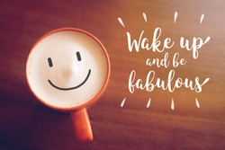 Inspirational quote on blurred coffee cup background with vintage filte