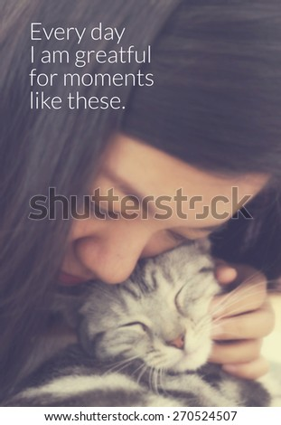 Inspirational quote & Young woman hug the cat blurred background with vintage filter