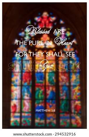 Inspirational religious quote with words Blessed are the pure of heart on background of stained-glass window inside the church