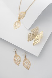 Inspired by nature jewelry set - Leaves shape earrings and necklace with butterfly shape earrings on white folded paper