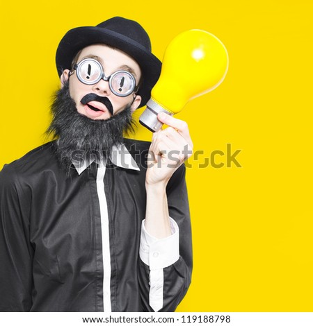 Inspired Marketing Businessman Wearing Humorous Glasses And Fake Beard Holding Massive Light Bulb In A Depiction Of A Big Idea