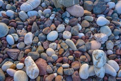 Inspiring background of round, beautiful and colorful rocks. A peaceful scene from an unspoiled beach on the ocean. Close up of spherical, rolling stones in a natural and nice disposition