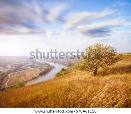 Inspiring image of the sinuous river flowing through hills. Picturesque and gorgeous morning scene. Location place Dnister canyon, Ukraine, Europe. Save environment. Explore the world's beauty.