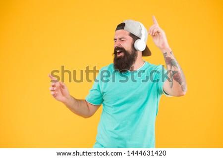 Inspiring song. Music library. Feel rhythm. Bearded guy enjoy music. Equalizer player settings. Lifestyle music fan. Man listening music wireless headphones. Bass low sound. Hipster headphones gadget. #1444631420