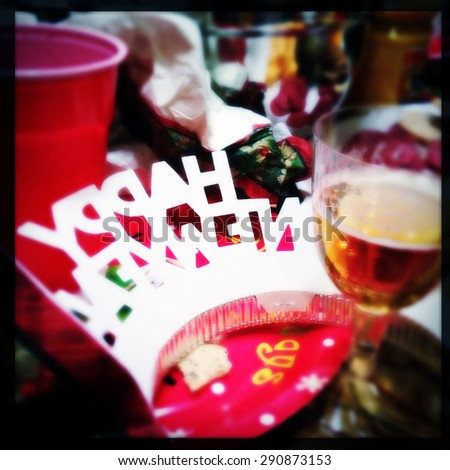 Instagram filtered image of a New Years party hat in an after party mess