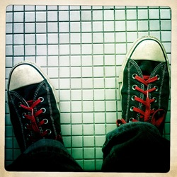 Instagram style image of sneakers on a tile floor