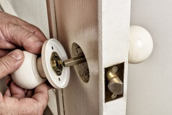 Install door latch with a screwdriver.