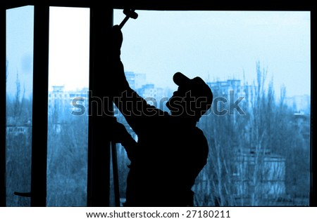 Installation of a window on a background of the house