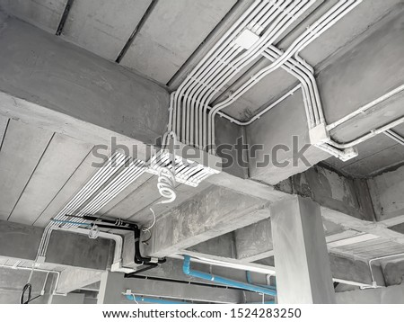 Installation of electrical wiring on the ceiling.Electrical cable system installation. Photo stock ©