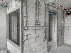 Installation of electrical wiring on the wall. Work plaster on masonry.Electrical cable system installation