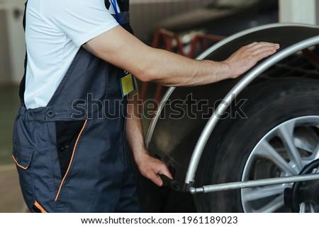 Installation of new tires. Wheel balancing machine. Work in garage Stock fotó ©