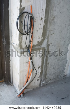 Installing communication wiring. Home wiring. #1142460935