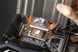 Installing cooler on CPU using thermal paste. Cooling desktop PC. Assembling and upgrade desktop computer. Close-up, selective focus
