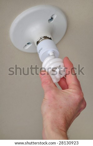 Installing energy efficient compact fluorescent light (CFL)