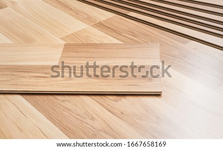 Installing laminated floor, detail on wooden tiles ready to be fit Photo stock ©