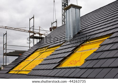 Installing of roof lights on a construction site