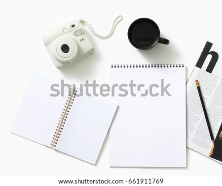 Instant camera along with sketch pad and magazine