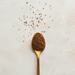 Instant coffee in a Golden spoon. Concept of instant coffee birthday celebration. Copy space. July 24