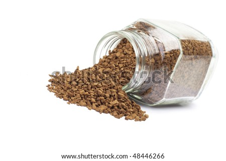 Instant coffee in glass bank on a white background.