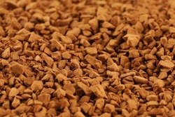 Instant coffee in granules close-up. Instant drink.