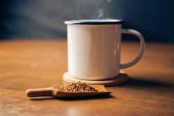 instant coffee on spoon.