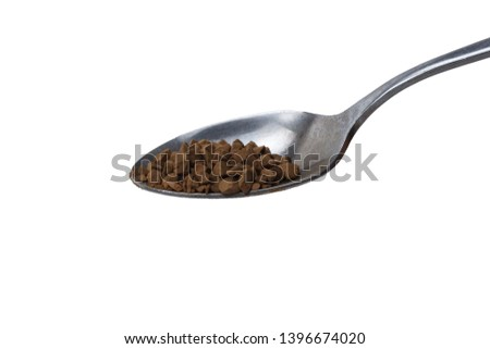 Instant granulated coffee in spoon from top view isolated on white background