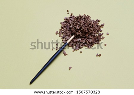 Instant granulated coffee in spoon on yellow background