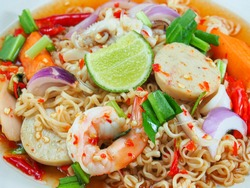 Instant noodle spicy salad with seafood, Thai noodle spicy mixed seafood salad, Mama Noodle Salad, Yum Mama Thai cuisine Yum traditional spicy hot