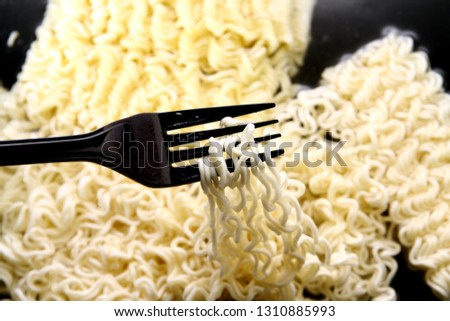 Instant noodles background / Instant noodles are a popular convenience food eaten all over the world