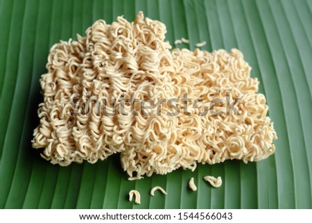 Instant noodles, Expired instant noodles and has moldy on banana leaf.Concept do not eat food expiration because it is not good for health.