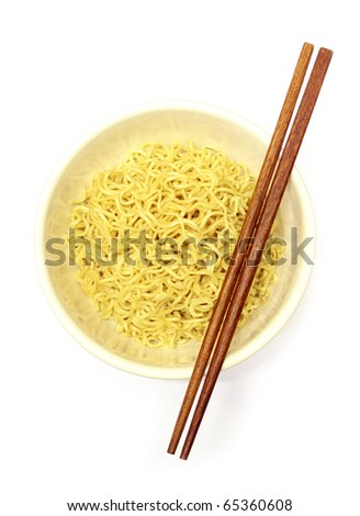 Instant noodles in bowl and chopsticks