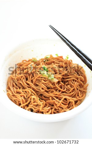 Instant noodles isolated on white background with chopstick