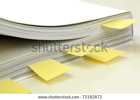 Instruction Manual marked with yellow post-it tags.  Soft focus.
