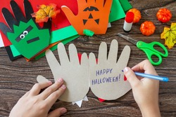 Instructions, step 19. Greeting card halloween on wooden table. Children's creativity project, crafts, crafts for kids