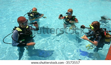 Instructor and students during scuba diving lessons