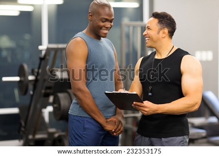 instructor explaining membership form to client in health club