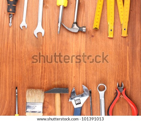 Instruments on wooden background #101391013